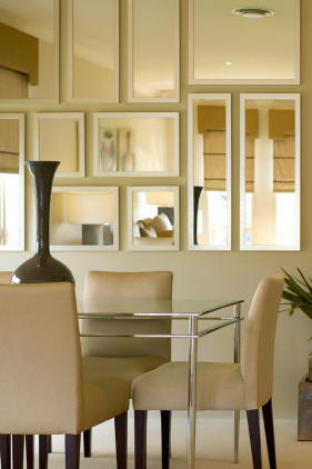 mirrors add light to a space through their reflective qualities