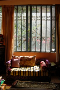 Moroccan Sofa and window with wrought iron grill