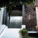 old_school_house_awful_metal_door
