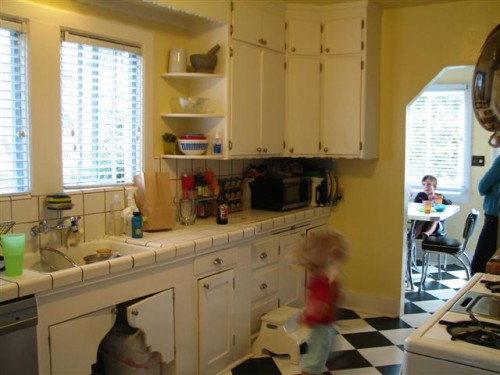 The Kitchen Still Has These Amazing 50s Cabinets With Detailed Wood Edging
